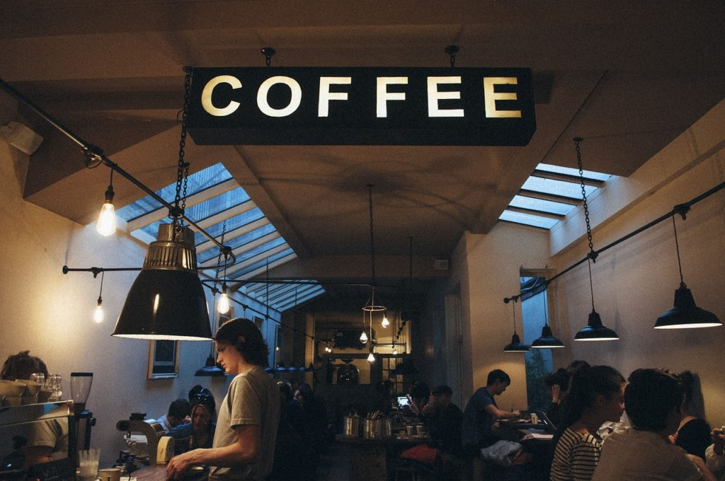 bright-coffee-sign-illuminates-cafe