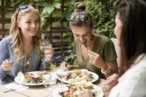 successful-cafe-happy-female-customers-laughing-over-salad