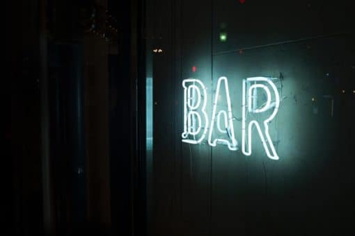 new-bar-welcoming-customers-with-neon-sign