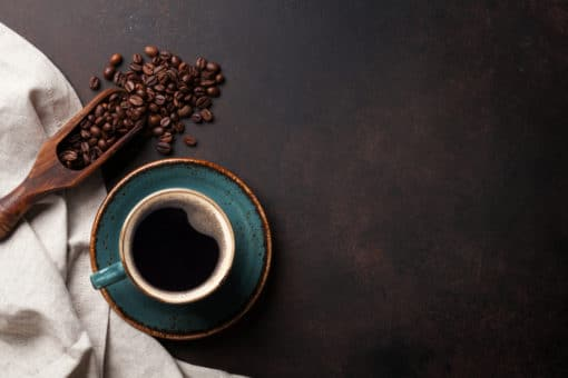 artistic-shot-of-coffee-beans-and-espresso