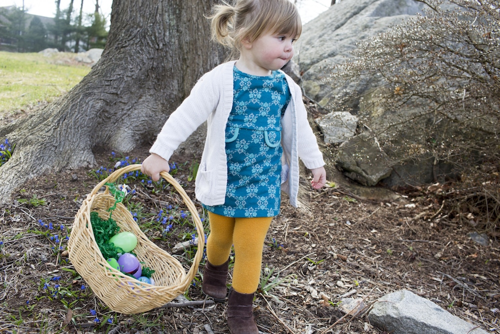 Toddler hunting for eggs on Easter Sunday.
