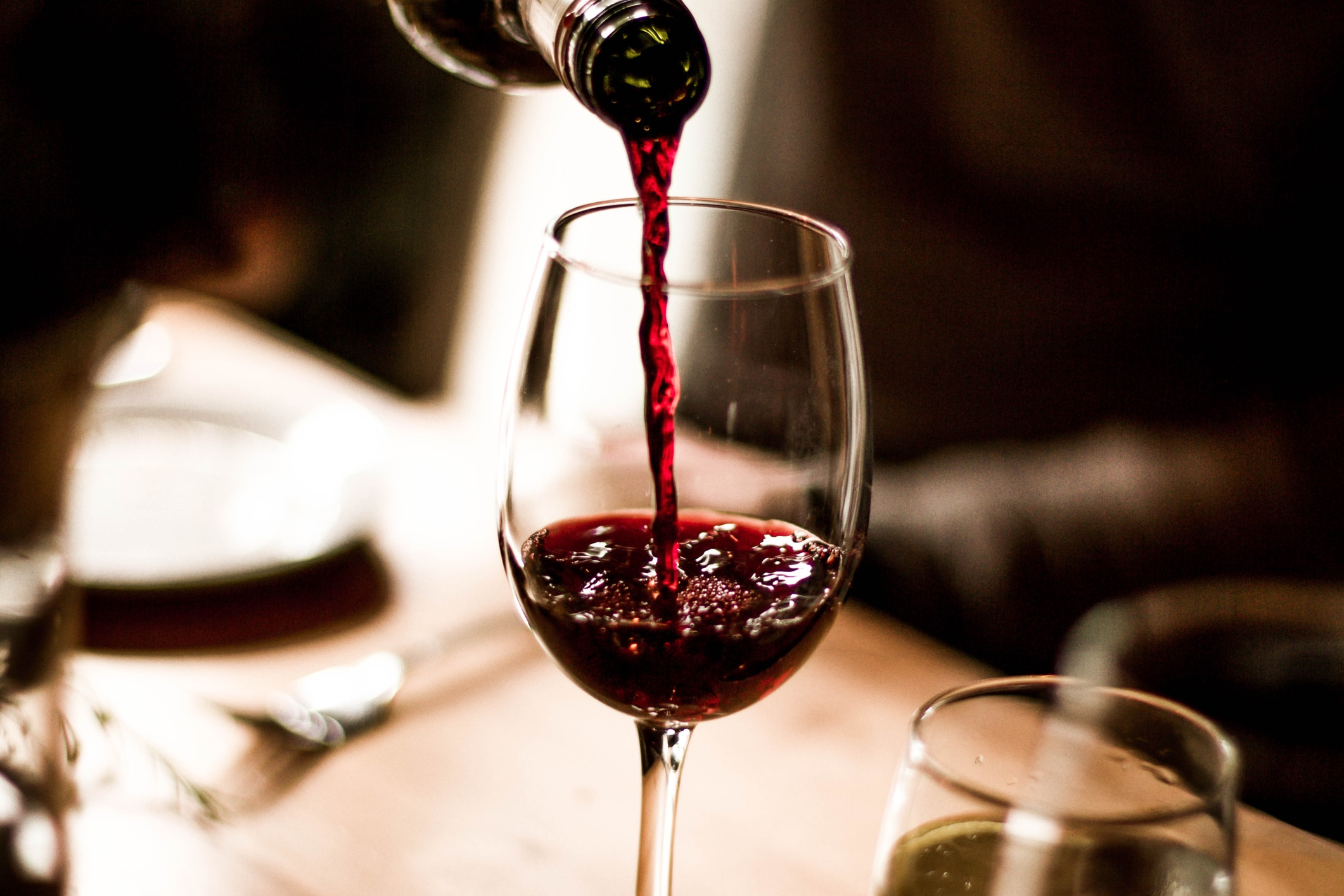 sommelier-pours-red-wine-at-restaurant
