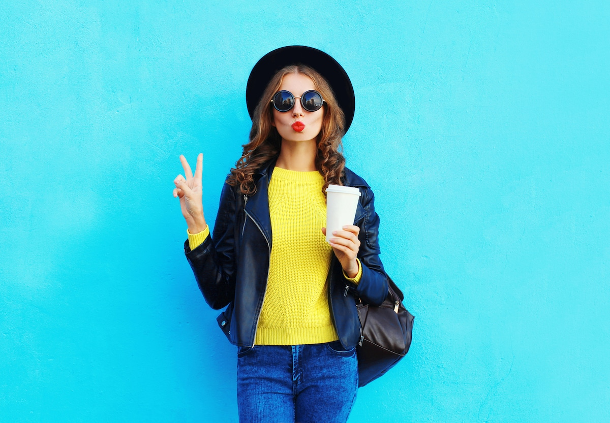 hip-trendy-girl-holds-coffee-cup