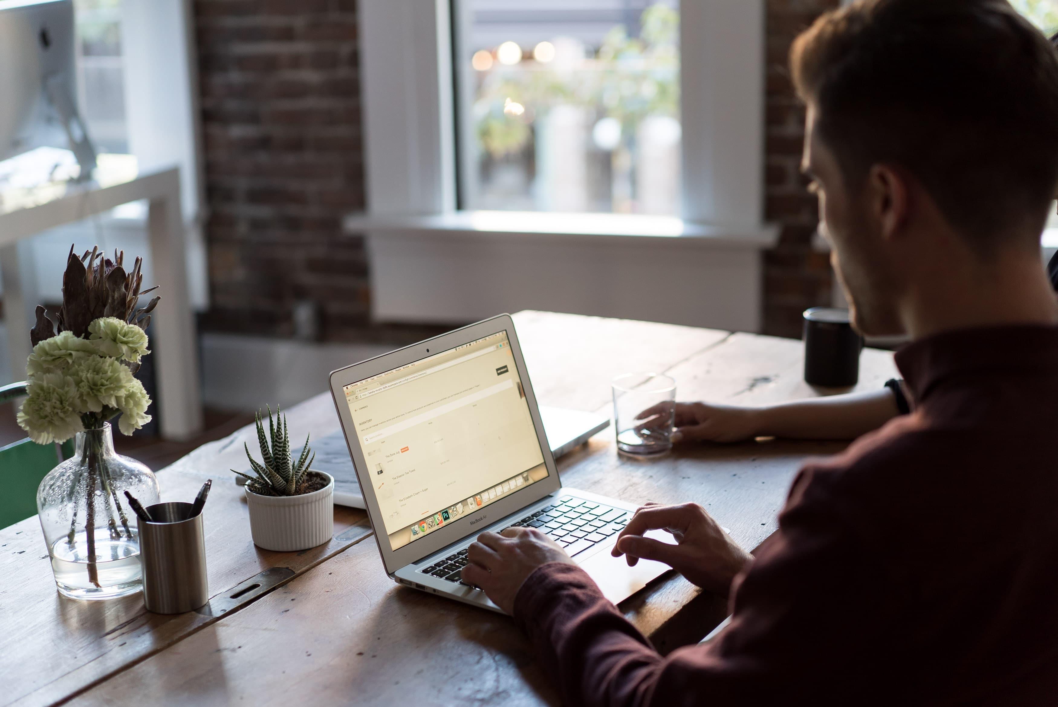 man-sits-at-desk-to-do-accounting-admin