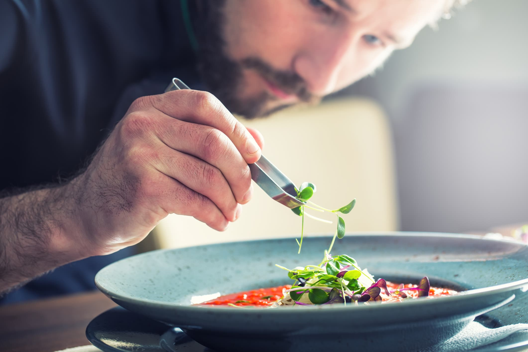 chef-applies-finishing-touches-to-dish