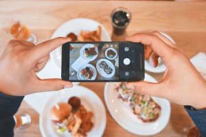 social-media-user-takes-food-photo-at-restaurant